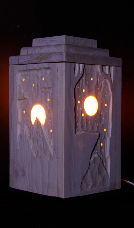 A four sided light box with landscapes carved in the sides ; Chance Tatum
