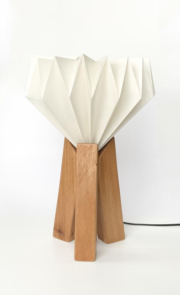 Innovative lamp design focusing on three wooden pillars. ; Zachary Wegscheid