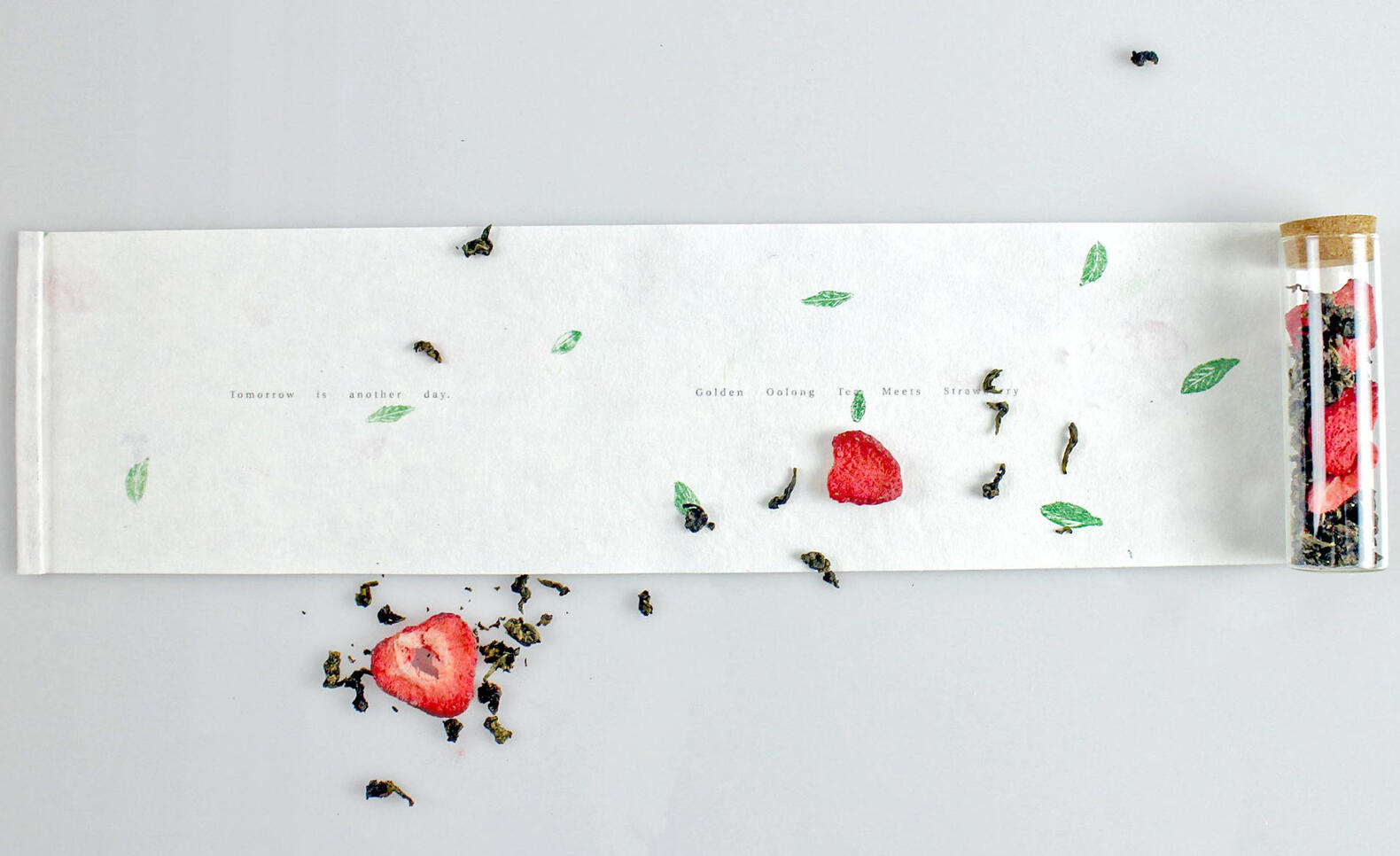 Photograph of a scroll, tea leaf, and strawberry ; Xingzi Liang